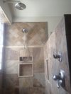 Close up of Brushed nickel rain shower and massage shower head.