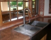 Top mount stainless steel Apron Front sink with High Arc Brushed Nickel Faucet.