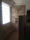 A tub shower combo turned into a walk in shower.  Brushed nickel fixtures.