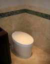 A Contemporary oval toilet.